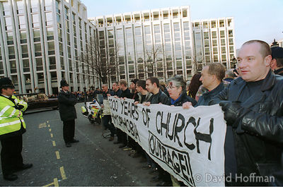 000121 The first demo of the new millennium. Outrage supporters with blood marked faces hold up a banner in front of St Pauls...