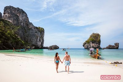 Adult couple hand in hand at the beach, Phi Phi islands, Thailand