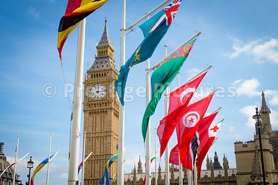 The Elizabeth Tower (Big Ben) against a Blue Sky with many Flags Flying