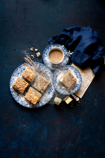 Gluten-free Coffee Cake with Coffee against a dark blue background
