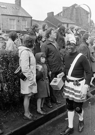 #77130,  The 'Nutters' Dance', Bacup, Lancashire,  1973.  On Easter Saturday every year the 'Coconut Dancers' gather at one b...