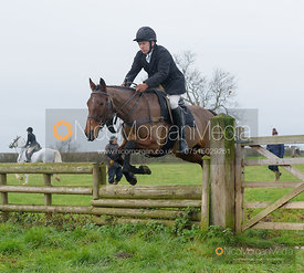 Russell Nearn jumping a hunt jump after the meet