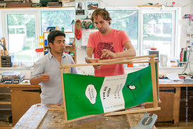 #73007,  Tomo Usuda and Tobe Beayens fixing a deckchair, carpentry workshop, Summerhill School, Leiston, Suffolk. The school ...