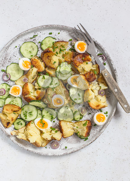 Roasted potato, cucumber and quail eggs salad.