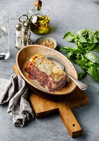 Lasagna Bolognese traditional Italian food on concrete background