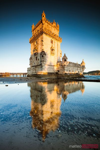 Belem tower reflected into water, Lisbon, Portugal