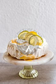 Pavlova with lemon curd and whipped cream