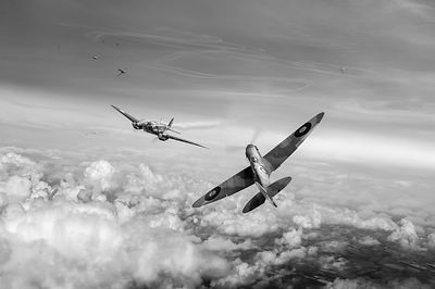 Spitfire attacking Heinkel bomber