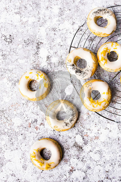 Lemon And Poppyseed Doughnuts With A Lemon Icing And Zest
