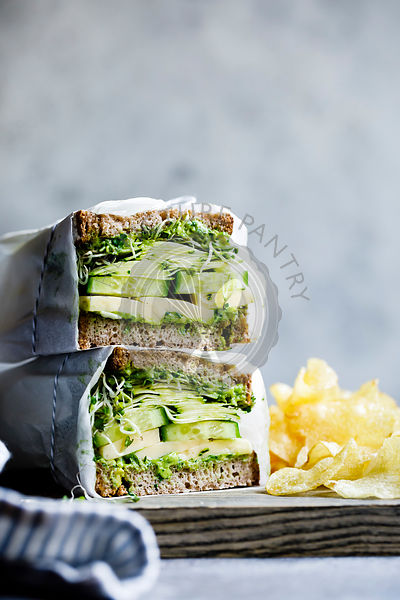 A healthy cheese and green salad sandwich on brown bread, with cucumber and cress.