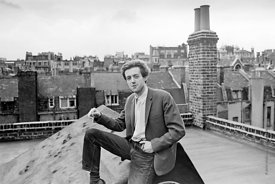 Cornelius Cardew (1936-1981), avant-garde musician and composer, on the rooftops, Fitzrovia, London.  3rd July 1970.
