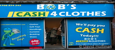 Shop offering cash for clothes, Roman Road, Bow London. The poverty business offering cash loans for people's clothes in the ...