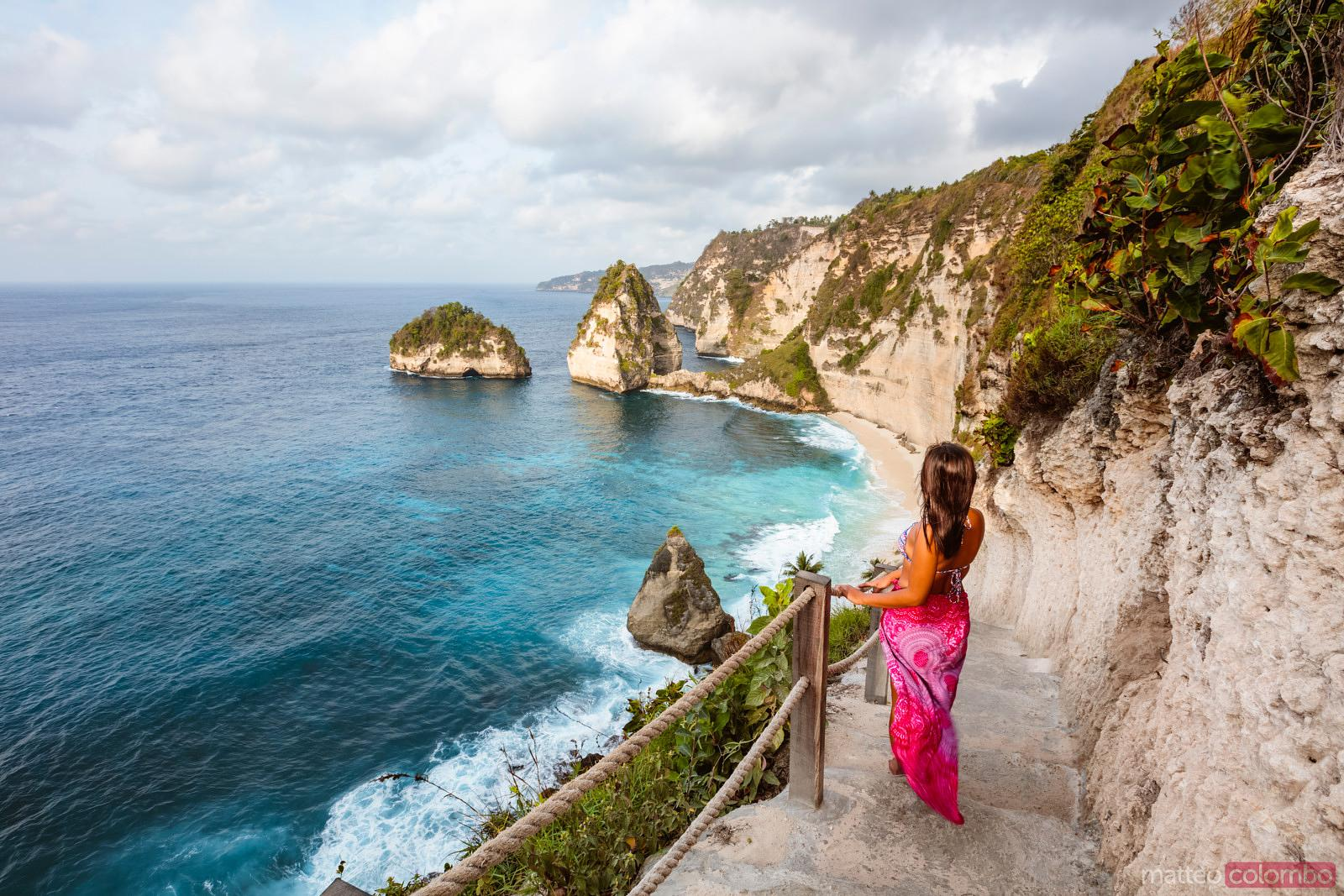 Female tourist at Diamond beach, Nusa Penida, Bali