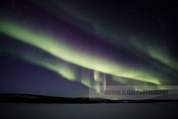 Northern lights above the Teno River in Lapland