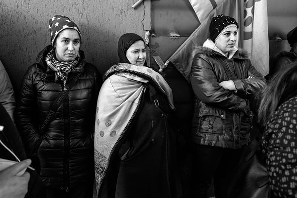 Hind (L), Fatiha and Shima listening to the press conference during which the tenants unions announced that they would withdr...