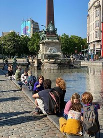 Brussels, Belgium - April 25, 2020: Jules Anspach fountain and Quai aux Briques in a bright Spring day during the confinement...
