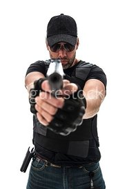 A Figurestock image of a man pointing a gun – shot from eye level.