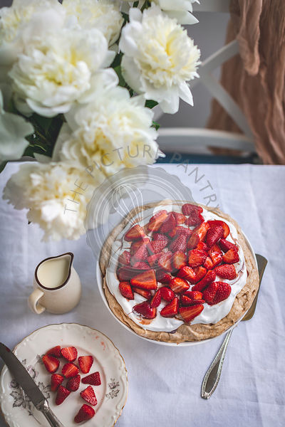 Pavlova cake with whipped cream and strawberries