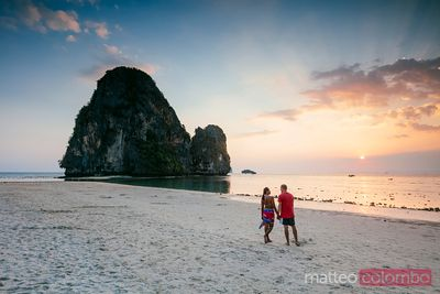 Man and woman at Phra Nang beach at sunset, Railay, Thailand