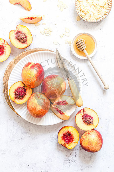 Fresh nectarines on a white plate