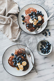 Healthy breakfast with banana pancakes with bluelerry and honey