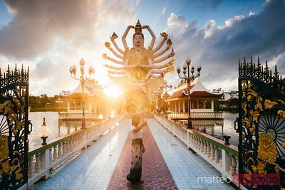 Asian woman taking selfie at Wat Plai Laem, Ko Samui, Thailand