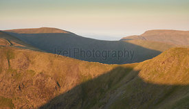 The ridgeline of High Street at sunrise with Thornthwaite in the distance to the left in the Lake District UK.