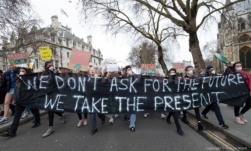 England, UK . 15.3.2019. London . Students skip school on strike demanding government action to stop global warming and clima...