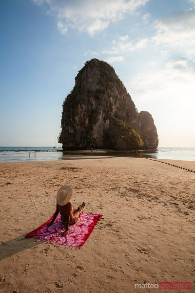 Woman sitting on the beach, Railay, Krabi province, Thailand