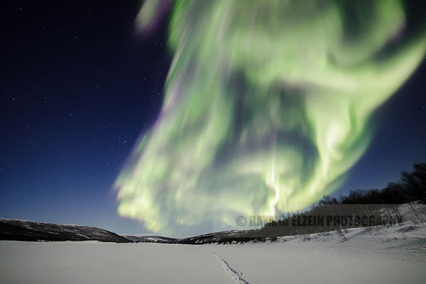 Northern lights above the frozen Teno river in Utsjoki, Finnish Lapland