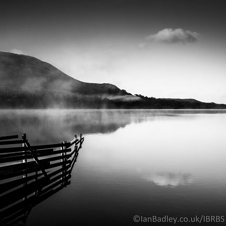 Still Loweswater at dawn with mist.
