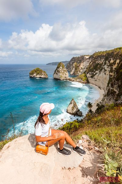 Woman admiring Diamond beach from lookout, Nusa Penida