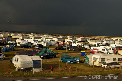 Dark thundery sky over a holiday camp at Camber Sands on the Kent coast.