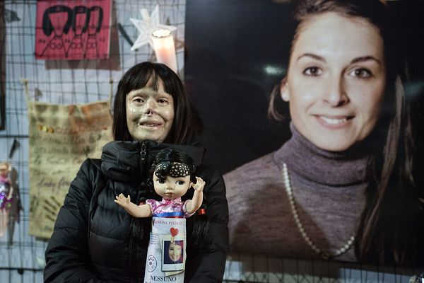 Valentina Pitzalis in front of a photo of Valentina Solesin, an Italian girl killed by terrorists in Paris on Nov 13; the dol...