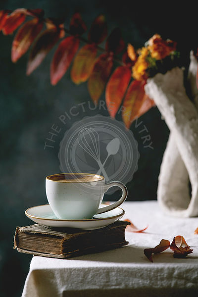 Coffee with autumn leaves