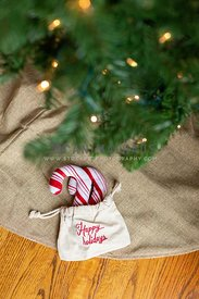 Happy Holidays gift bag under Christmas Tree