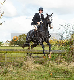 Alex Tordoff jumping a fence at Cheseldyne - Cottesmore Hunt Opening Meet 2019