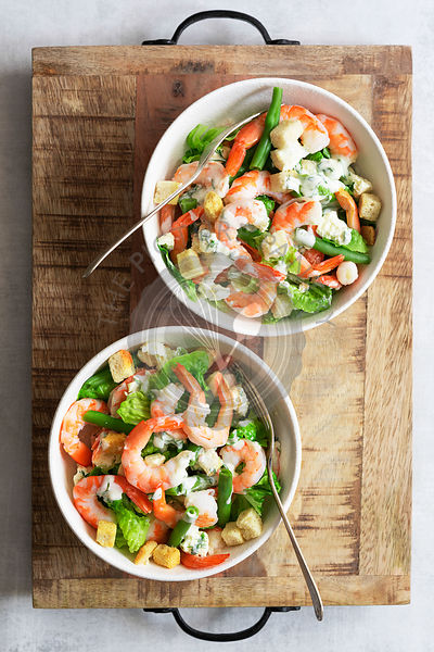 Prawns with green salad and dill dressing.