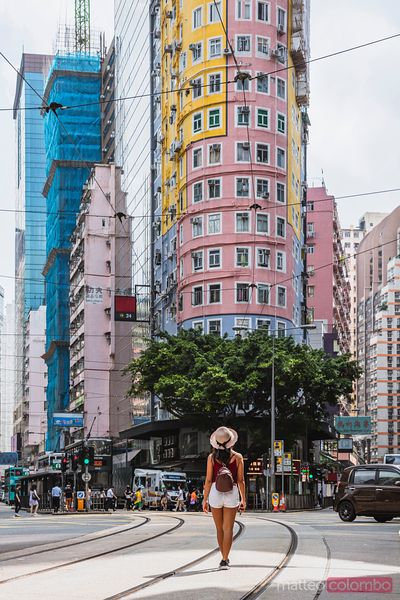 Woman in front of flatiron building, Hong Kong