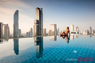 Woman in bikini in an infinity pool, Bangkok, Thailand