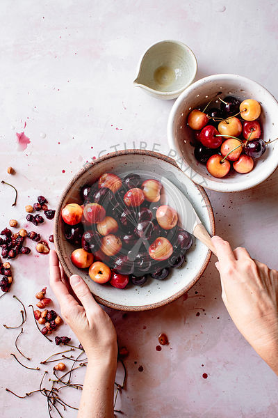 Red and white cherries in a bowl with stones removed.