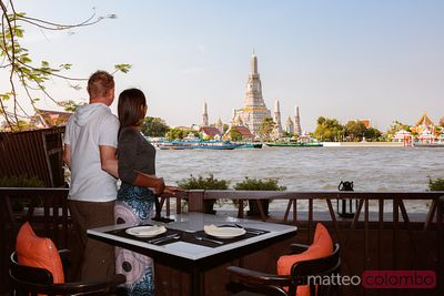 Couple enjoying the view of Wat Arun, Bangkok