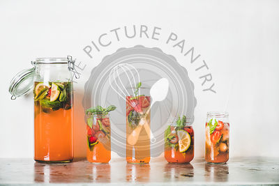Fresh homemade strawberry and basil lemonade in tumblers, copy space