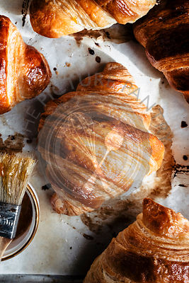Cluseup of croissant with apricot jelly