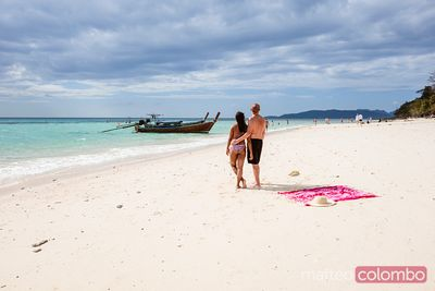 Adult couple relaxing at bamboo island, Krabi province, Thailand