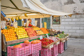 VENICE, ITALY - OCTOBER 25, 2017: A typical fruit and vegetable market stall in Venice, Italy.