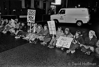 "YA19-13-1 East End activist women in the 1980s.Woman with ""No Cruise"" placard Linda Hurcombe. Woman centre looking down Riche..."