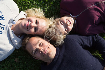 A family lying on grass
