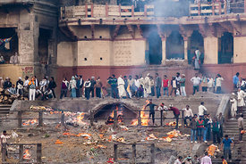 VARANASI, INDIA - February 11, 2015: The cremation of bodies at the holiest Manikarnika Ghat on the banks of the Ganges river...