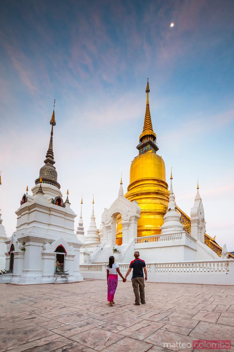 Couple at Wat Suan Dok at sunset, Chiang Mai, Thailand